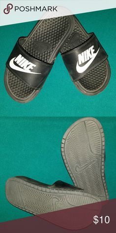 Nike Slides Boys Nike slides size 2Y, the picture shows the wear they've had.... Nike Shoes Sandals & Flip Flops