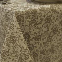 Mantel resinado antimanchas topo con flores en beige. A medida y super práctico.