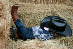 My cowboys one year old. One of his cute farm pictures :)