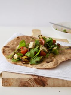 Roasted eggplant and tomato salad with cashew cheese on flatbread