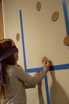 Pin the Football: In this spin on the classic children's game, blindfold the little ones and see who can make it closest to the middle of the uprights. Click through to find more fun game ideas for your Super Bowl party.