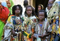 Young Wolof Mourides infront of Mosques in Senegal.  The Mouride Sufi Brotherhood is a sect of Islam, The Mouride Sufi Order was founded by Sheikh Ahmadou Bamba in 1883 in the Senegambia region it boasts over four million followers today, mostly concentrated in Senegal and The Gambia.