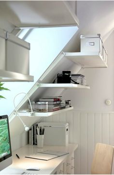 Clever way to add storage shelves to a sloped wall or ceiling. Useful for an attic room or an A-frame house.