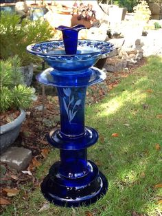 """Cobalt blue glass bird bath for the garden. The middle """"pedestal"""" vase has stylized tulips etched into the glass. Beautiful!"""
