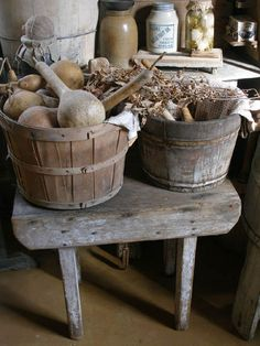 Fall gourds and bittersweet in primitive wood buckets.