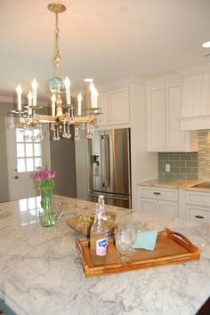 I like this granite for the kitchen countertops -- Glacier White granite kitchen remodel Green Countertops, Kitchen Countertops, Granite Backsplash, Kitchen Cabinets, Kitchen Benchtops, Quartzite Countertops, White Counters, Bathroom Countertops, Kitchen Redo