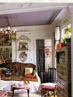 The ceiling! The couch throw! The beaded curtain!  All the details of this little Paris apartment work so well together.