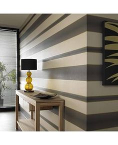 love the grey and white stripped accent walls.