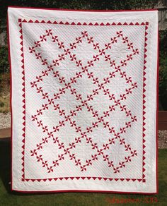 Red and White Pinwheel Quilt, hand pieced, hand quilted
