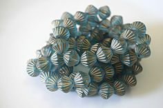 SAVE 10% use coupon code PIN10 Beautiful aqua blue African bicone beads. These Czech glass beads are accented with gold grooves and have a frosted matte finish and sparkle, what a beautiful focal or acce...