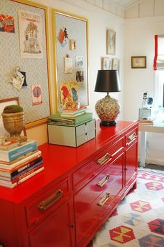 I like the bold red dresser with red accents in the rug, shades, and bulletin boards