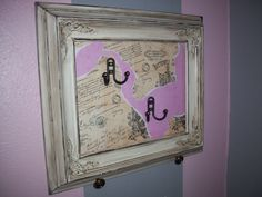 Old picture frame refurbished to hang jewelry, handbags, etc.