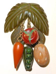Vintage veggie Bakelite pin, via the Bakelite Museum.