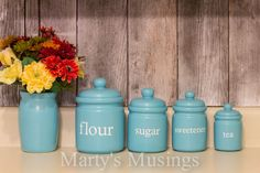 Whimsical Kitchen Canisters from Marty's Musings. Made with diecutting machine and vinyl.