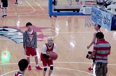 Suga playing basketball