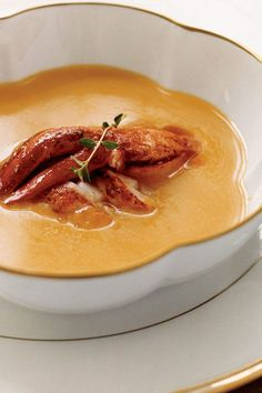 This pumpkin soup recipe incorporates pumpkin or butternut squash, lobster, onion, garlic, thyme, rosemary, dry white wine, cinnamon and nutmeg to create the ultimate seafood recipe meets fall recipe. Whether you're making this pumpkin recipe as a seafood packed dinner or packing it up for a lunch the next day, it's a great choice for a fall recipe.#seafoodrecipes #lobsterrecipes #pumpkinrecipes #souprecipes #fallrecipes #pumpkinsoup