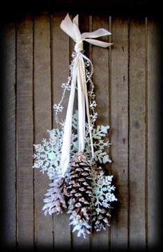 Snowflakes, pines, and ribbon.