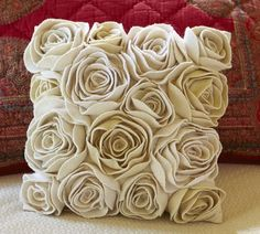 rosette pillow.  I love this, but I definitely do not want to take the time to make it! HA HA HA so true!!!! rosettes take so long, this pillow would take forever!!!!