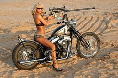 Can't decide which is hotter...the bike, the gal, or the gun she's packing