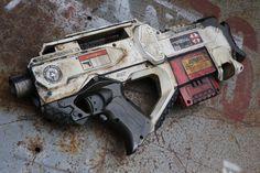 MNU desert assault rifle by on DeviantArt Nerf Water Guns, Cool Nerf Guns, Nerf Mod, Nerf Gun Attachments, Newest Nerf Guns, Modified Nerf Guns, Nerf Darts, Cool Masks, Custom Paint Jobs