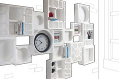 Styrofoam packing inserts used to create unique shelving system.