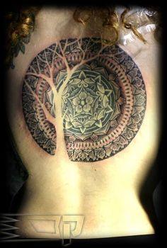 alternate tree of life style, with a universal mandala.  {ARI AKKERMAN    Heidelberg, Germany ...}