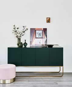 emerald green buffet with brass legs and dusty pink ottoman