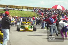 Martin Brundle, Benetton B192, negotiates the crowds after finishing 3rd, 1992 British Grand Prix, Silverstone. #f1 #formula1 #silverstone #motoracing #motorsport #racing #crowd #crowds