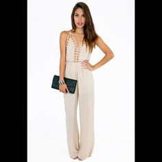 Tobi Callie cut out jumpsuit Brand new never worn. If you are short like me (5'1) you will need to have it hemmed or wear really tall heels :). Tobi Pants Jumpsuits & Rompers
