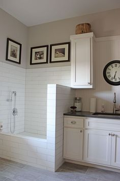 Burrows Cabinets white painted laundry room cabinets with tiled dog shower. Mud room, back entrance idea Tiny Laundry Rooms, Mudroom Laundry Room, Laundry Room Cabinets, Laundry Room Design, Laundry In Bathroom, Hidden Laundry, Laundry Shelves, Laundry Room Bathroom, Downstairs Bathroom