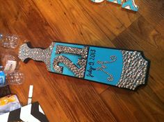 I don't know whose paddle this is, but it has my initial and 21st bday date.... want.