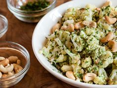 Roasted Cauliflower with Cilantro Pesto by Josef Centeno, tastingtable who combines cilantro, lime zest, cotija (a crumbly Mexican cow's-milk cheese) and cashews for a deliciously different take on the traditional basil-and-pine nut combo. #Cauliflower #Cilantro_Pesto