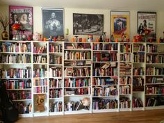"""When you walk into my home, you are instantly greeted by roughly 1,500 of my closest friends - my books! I collect anything I can get my hands on...from history and politics to adventure, sci-fi, romance, biographies, and more! There is nothing I love more than discovering a new author and living in the world they open up for me. As you can see from this set of shelves in my living room, I can barely contain my collection anymore!"""