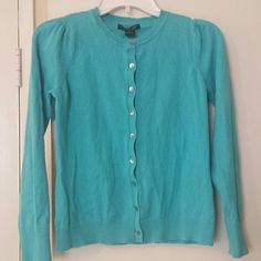 August Silk Cardigan Long sleeve turquoise cardigan with cute pleaded shoulders. Has buttons straight down the front. Has a small hole/unstiching in the back neck area that can easily be fixed with a needle and thread. Is priced low due to that. Gently used. august silk Sweaters Cardigans
