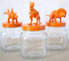 Orange Dinosaur Jars. Just spray paint animals an eye-popping color and glue them to a lid to DIY the perfect cookie jar.