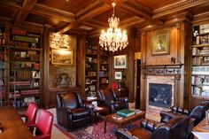 This library is in the English Tudor style. The bookcases are divided into bays by pilasters with hand-carved decorative elements. Waffle Ceiling, Moulding And Millwork, Big Doll House, Classic Library, English Library, Modern Mansion, Ceiling Beams, Coffered Ceilings, Living Room Inspiration