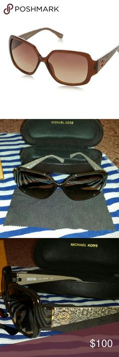 Michael Kors (M2748S) ZUMA Sunglasses in brown New without tags--these stylish oversized rectangular brown plastic framed sunglasses feature a brown snakeskin print on the arms with signature Michael Kors logo on the temples. Brown gradient lenses with 100% UV protection make these glasses a necessity for a gal on the go. *just the glasses (no case, etc.) *smoker Michael Kors Accessories Sunglasses
