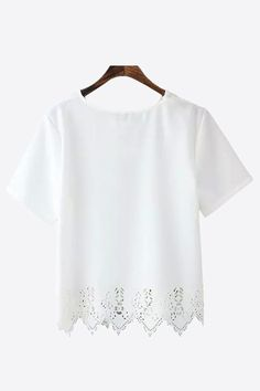 This item is shipped in 48 hours, including the weekends. This white short sleeve-top is plain with the exception of a lace style cutout along the hem, making it the ideal choice for mixing and matchi