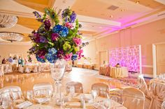 A Spring Palette for a Symbolic Wedding at Four Seasons Hotel Austin - loving the peacock feathers