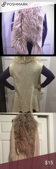 Faux fur collared sweater vest Beige faux fur sweater vest with front pockets.  Very stylish and cute.  You will be the eye of all the lions 🦁😉 is a size M but I think could easily could fit a size large.  There is a spot missing some fur. Costa Blanca Jackets & Coats Vests