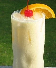 Tropical Bliss (1 oz. Malibu Coconut Rum 1 oz. Pineapple Rum 1 oz. Orange Vodka 2 oz. Orange Juice 2 oz. Pineapple Juice 2 oz. Half & Half Orange slice/Cherry for garnish). by maryellen