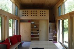 EDGE, or Experimental Dwelling for a Greener Environment, designed by a small Stevens Point, WI firm, Revelations Architects. The abode is so bitty, in fact, that it doesn't qualify as an actual house in much of Wisconsin, where 750 or 800 square feet of floor space is required.  Set on a bluff on the northernmost tip of the state, overlooking Chequamegon Bay on Lake Superior.  (Photo 2 of 2...shows the interior!)  AWESOME!!!