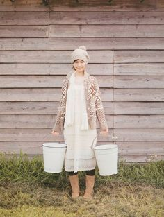 wish I looked this cute when I went out to milk! lol, that muslin dress would be covered with mud...looks cute though!