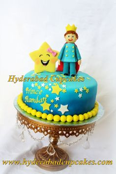 A custom Twinkle Twinkle Little Star themed first birthday cake for a Little Baby Bum fan! All edible handmade decoration, including the prince, star & little twinkling stars on delicious Chocolate Delight cake!