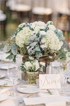 Wedding reception centerpiece,  hydrangea,  dusty miller, sweat heart roses.