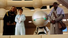 HITCHHIKER'S GUIDE TO THE GALAXY (2005) comedy science fiction, based on the book of the same name by Douglas Adams. It stars Martin Freeman, Sam Rockwell, Mos Def, Zooey Deschanel and the voices of Stephen Fry (the guide book) and Alan Rickman (Marvin, the Paranoid Android).