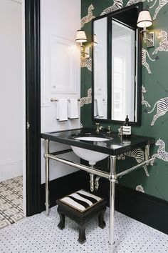 Tile from Ann Sacks and Scalamandré wallpaper scream tailored sophistication in Susan Greenleaf's San Francisco abode.