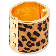 Tell us: Are you into this leopard printed gold cuff? Click to find more variations of the print trend!