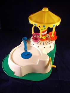 Vintage 1981 Fisher Price Change a Tune Carousel Little People Record Player on Etsy, $13.65 CAD