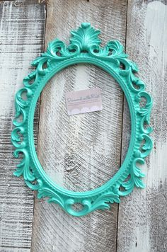 Beautiful ornate baroque style open oval frame is painted in a pretty aqua / turquoise color and is great for any room of the house or any